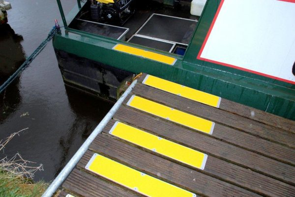 Yellow bolt down plates on decking B